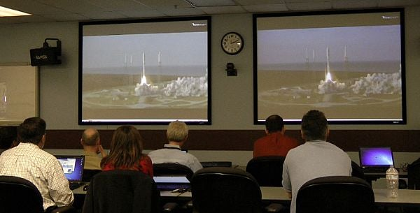 officials watch the launch of MUOS-1 satellite.
