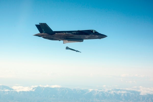 F-35B Lightning II launches guided weapon against ground target.