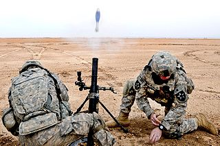 US soldiers fires a 60mm motor