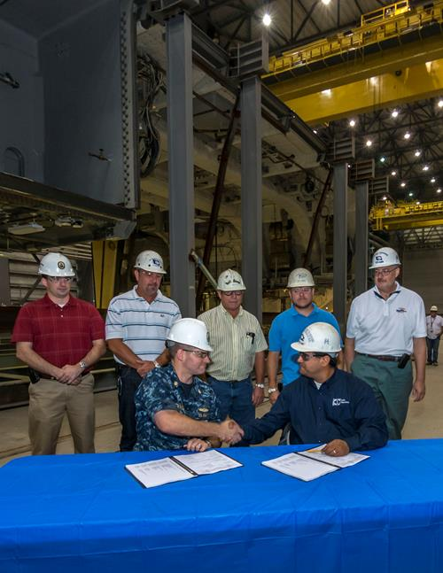 Officials during composite hangar delivery to the US Navy for the USS Michael Monsoor (DDG 1001
