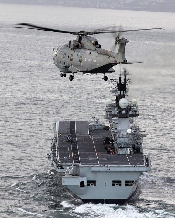 UK Navy aircraft and frigate