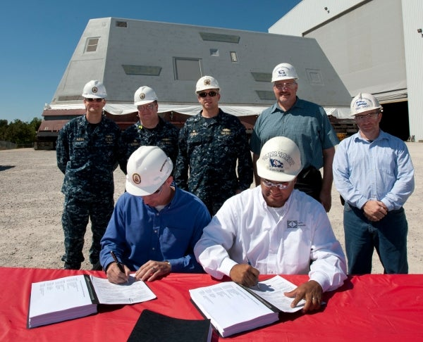 Officials sign the DD 250 documents